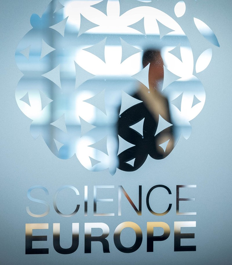 Large shot of Science Europe logo printed on glass pane