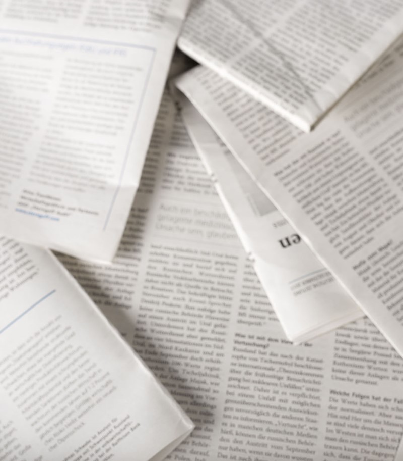 Overhead shot of blurred pile of academic articles